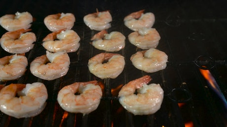 Shrimps being fired on the grill