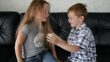 Siblings play fighting at home