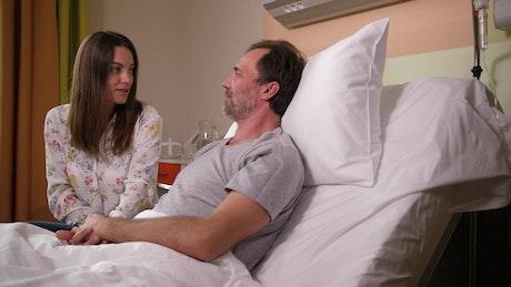 Sick man talking to his wife