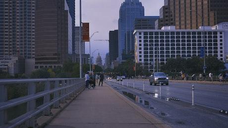Sidewalk of a big city in a rotating shot