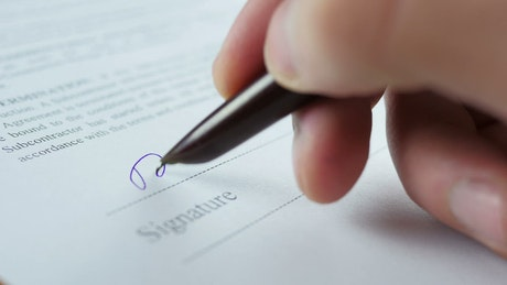 Signing a business contract close up