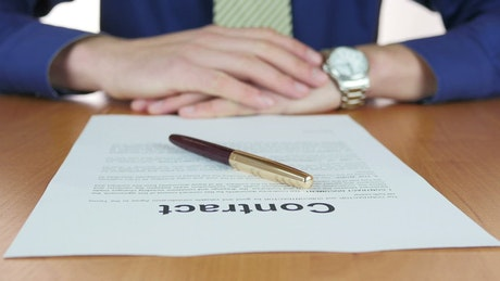 Signing a contract with a pen