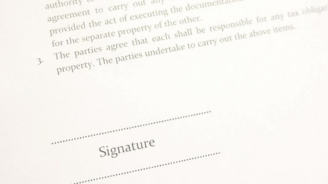 Signing a document with blue ink