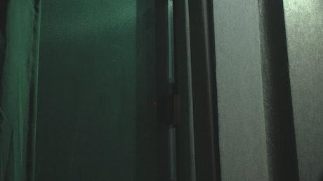 Silent thief peeking inside a house