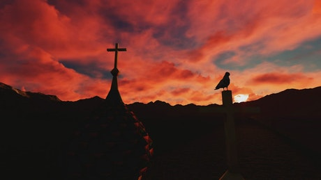 Silhouette of a crucifix at sunset, landscape