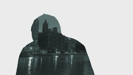 Silhouette of a man and a city