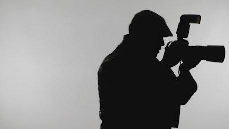 Silhouette of a spy taking photos
