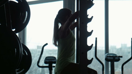 Silhouette of a woman doing exercise