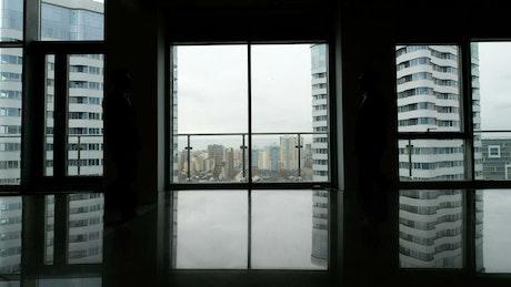 Silhouette of business handshake in skyscraper