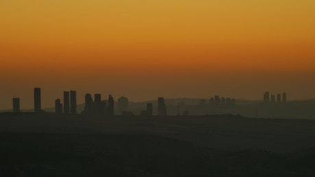 Silhouette of city buildings in the sunrise