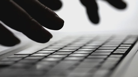 Silhouette of hands typing