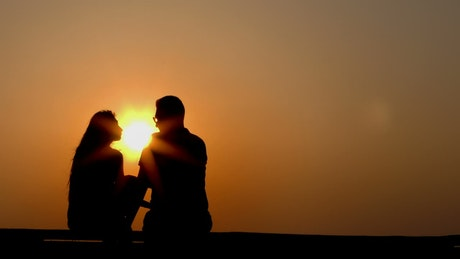 Silhouette of lovers at sunset, static shot