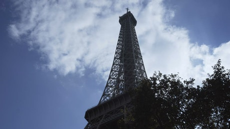Silhouette of the Eiffel tower under a blue sky