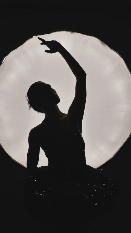 Silhouette of young ballerina dancing in tutu