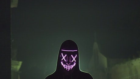 Silhouetted man with LED light mask