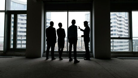 Silhouettes of a business meeting