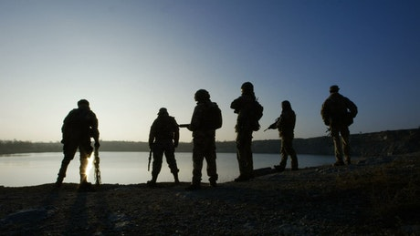 Silhouettes of soldiers in the sunset
