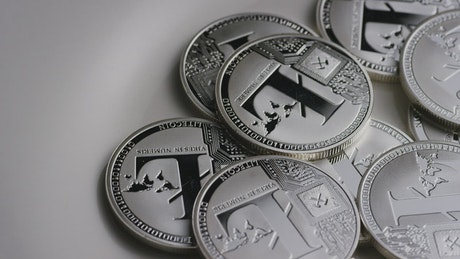 Silver Litecoins coins slowly rotating
