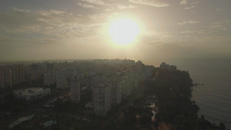 Silver sunset above a city