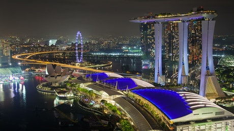 Singapore cityscape and harbor at night