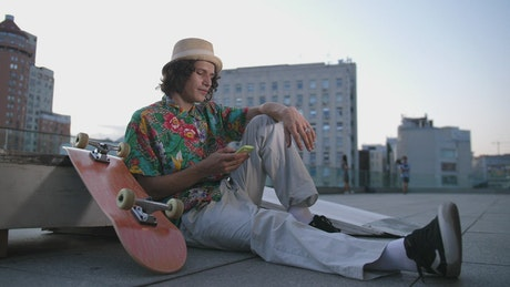 Skater relaxing in the city