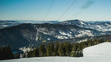 Ski lift in the mountains, time-lapse