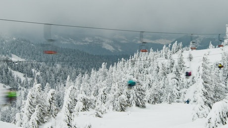 Ski lift over a frozen mountain forest