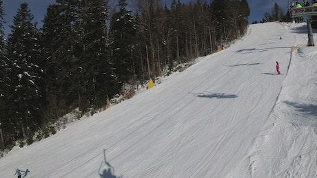 Ski lift shadows in the mountain track