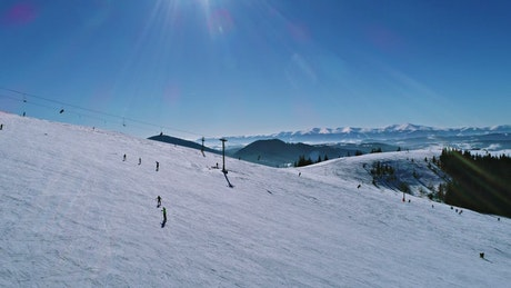 Skiers enjoying a sunny day in the mountains