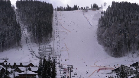 Skiers enjoying the mountain in the snow