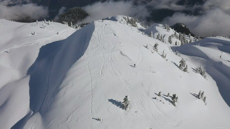 Skiers going down a Canadian mountain