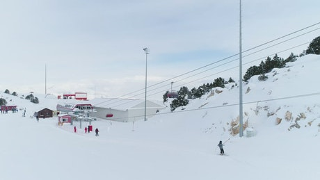Skiers going up hill