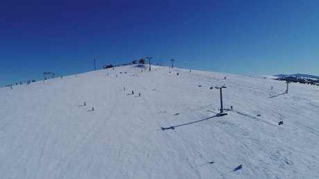 Skiers on a practice mountain, aerial view