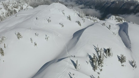 Skiers on top of a snowy mountain in Canada
