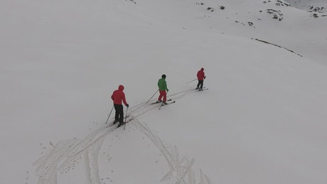 Skiiers going down the mountain