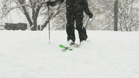Skiing at a park during heavy snowfall