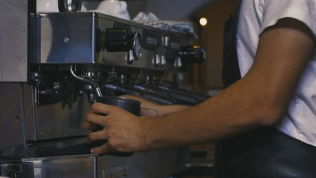Skilled employee working in a coffee shop