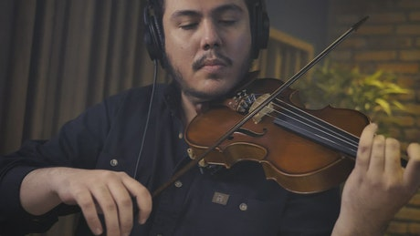 Skilled violinist playing in a recording studio