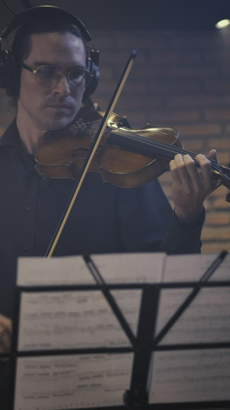 Skilled violinist playing with sheet music