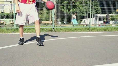 Skillful basketball player dribbling the ball