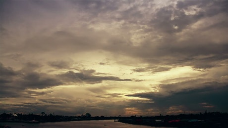 Sky with clouds above the river of a city