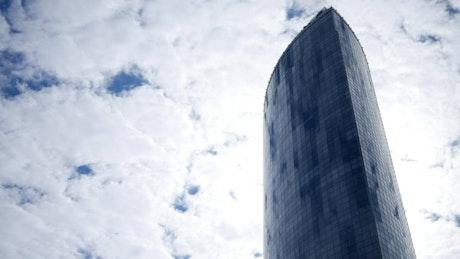 Skyscraper and a cloudy sky
