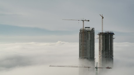 Skyscraper constructions above the clouds