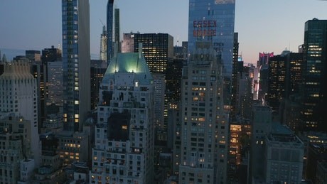 Skyscrapers at dusk, front aerial view