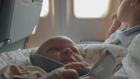 Sleepy baby on a plane