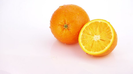 Slices of orange falling