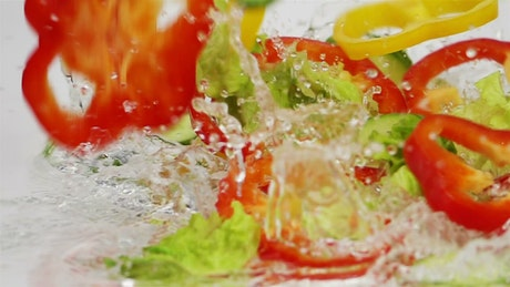 Slices of vegetables falling into the water