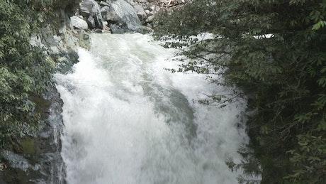 Slow motion of waterfall water falling