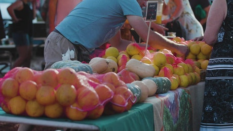Slow motion video of a fruit and veggie stand