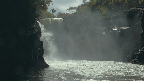 Slow motion waterfall and mist
